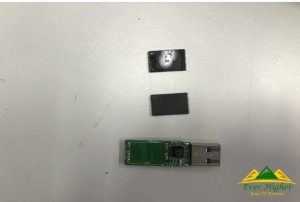 take out the memory chip of the USB and label the memory chip 1 and 2 to denote the front and back